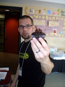 Shaun exhibiting one of the cupcakes in the VegFest 2012 cupcake contest he organized. This could be you!